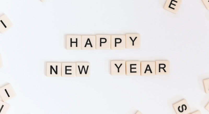 Happy New Year spelled with Scrabble letters
